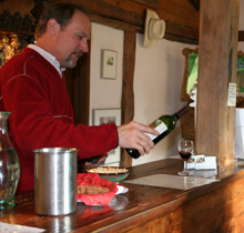 Pouring wine to taste at Greenbank Cellars.